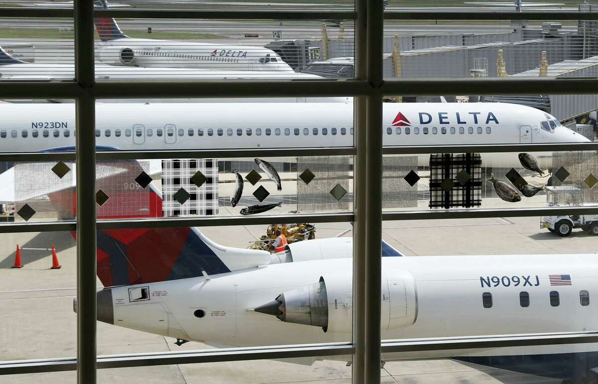 In this Monday, Aug. 8, 2016, file photo, Delta Air Lines planes are parked at Ronald Reagan Washington National Airport, in Washington. A California family says they were forced off a Delta plane and threatened with jail after refusing to give up one of their children's seats on a crowded flight. A video of the April 23, 2017, incident was uploaded to Facebook on Wednesday, May 3, 2017, and adds to the list of recent encounters on airlines that went viral, including the dragging of a passenger off a United Express plane.