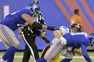 CORRECTS DAY AND DATE - Pittsburgh Steelers linebacker T.J. Watt (90) sacks New York Giants quarterback Josh Johnson (8) during the first quarter of an NFL preseason football game, Friday, Aug. 11, 2017, in East Rutherford, N.J. (AP Photo/Bill Kostroun)