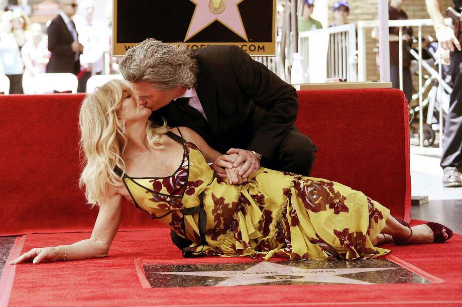 Goldie Hawn and Kurt Russell kiss at a ceremony honoring the couple each with stars on the Hollywood Walk of Fame on Thursday, May 4, 2017, in Los Angeles. Photo: Photo By Richard Shotwell/Invision/AP   / 2017 Invision