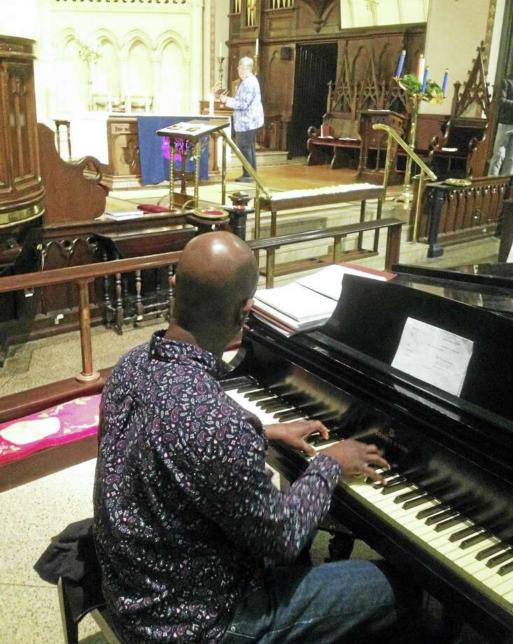 "Middletown's Church of the Holy Trinity hosts the annual service for the homeless in 2015. This year, The Coalition on Housing and Homelessness announced that <a href=""http://www.middletownpress.com/general-news/20161225/ron-krom-is-the-middletown-press-person-of-the-year-for-2016"">as of Oct. 11, 2016, all chronically homeless on the waiting list have been matched with housing.</a> Photo: File Photo"