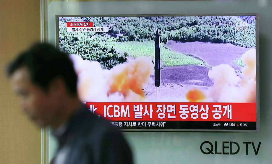 A man walks by a TV screen showing a local news program reporting about North Korea's missile firing at Seoul Train Station in Seoul, South Korea, Wednesday, July 5, 2017. North Korea's newly demonstrated missile muscle puts Alaska within range of potential attack and stresses the Pentagon's missile defenses like never before. Even more worrisome, it may be only a matter of time before North Korea mates an even longer-range ICBM with a nuclear warhead, putting all of the U.S. at risk. Photo: Lee Jin-man / AP Photo  / Copyright 2017 The Associated Press. All rights reserved.