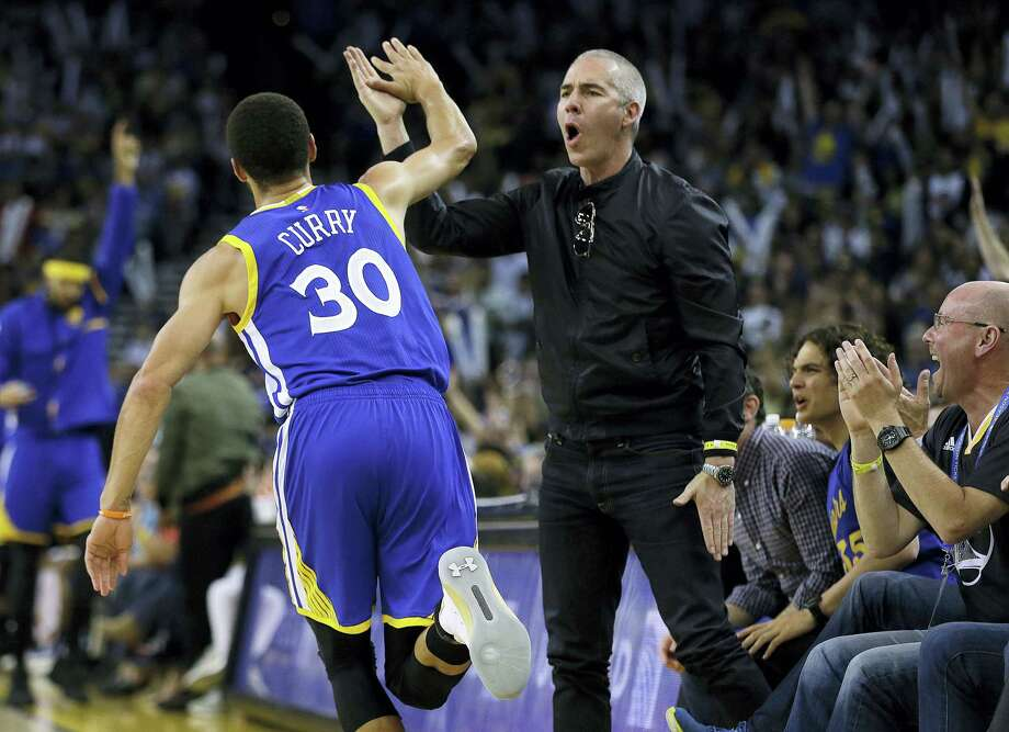 Golden State Warriors' Stephen Curry celebrates with a fan after scoring against the Washington Wizards during the second half of an NBA basketball game on April 2, 2017 in Oakland, Calif. Photo: AP Photo — Ben Margot  / Copyright 2017 The Associated Press. All rights reserved.