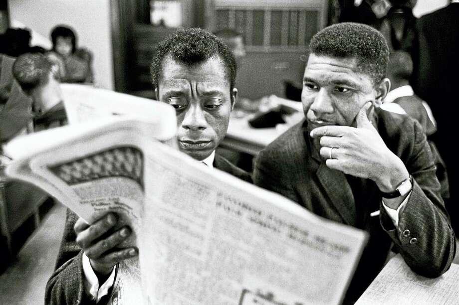 James Baldwin (left) in 1963 in Mississippi, where he visited the NAACP's Medgar Evers. Photo: Courtesy Of Steve Schapiro Via The Washington Post   / Steve Schapiro