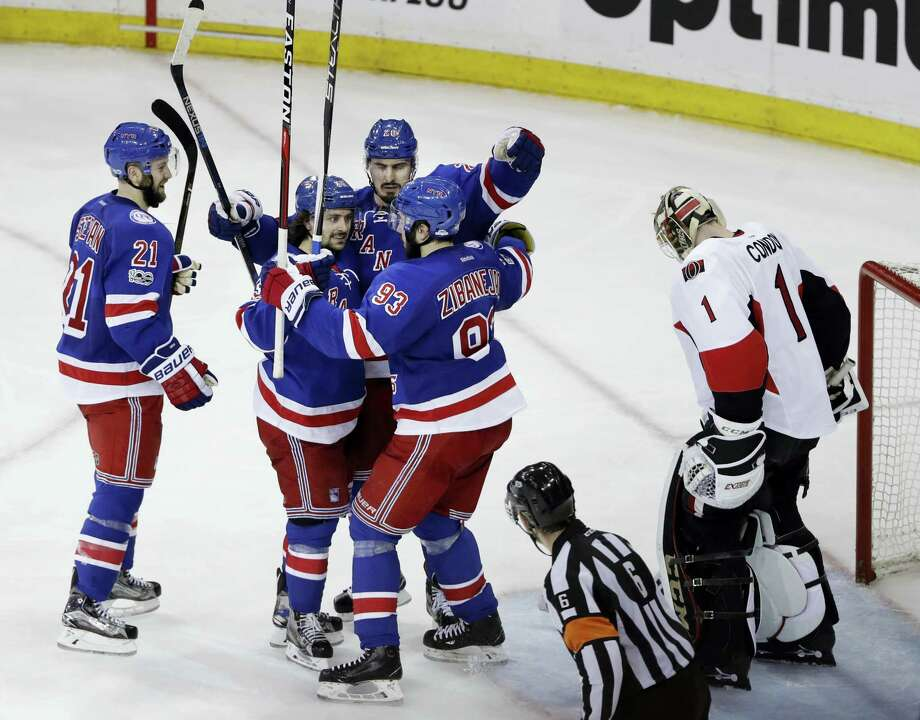 The Rangers' Derek Stepan (21), Mika Zibanejad (93) and Mats Zuccarello (36) celebrate with Chris Kreider after Kreider scored in the third period Thursday. Photo: Frank Franklin II — The Associated Press  / Copyright 2017 The Associated Press. All rights reserved.