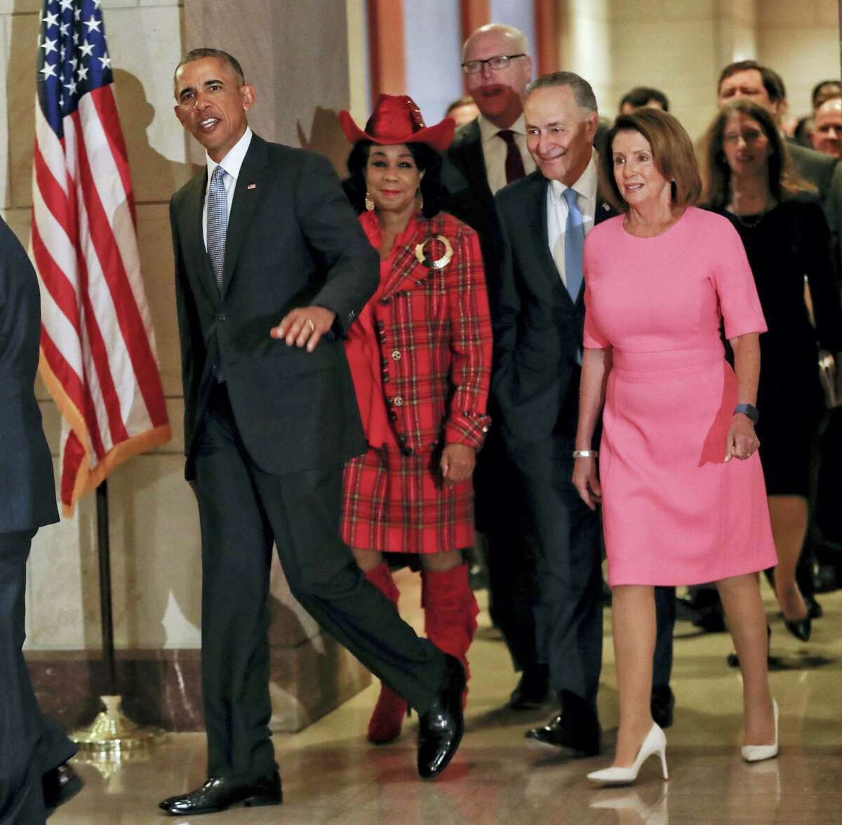 President Barack Obama waves as he arrives on U.S. Capitol Hill in Washington on Jan. 4, 2017 to meet with House and Senate Democratic leaders. Walking with him is Rep. Federica Wilson, D-Fla., Rep. Joseph Crowley, D-NY., Senate Minority Leader Charles Schumer of N.Y., and House Minority Leader Nancy Pelosi of Calif. Obama is at the Capitol to give congressional Democrats advice on how to combat the Republican drive to dismantle his health care overhaul.