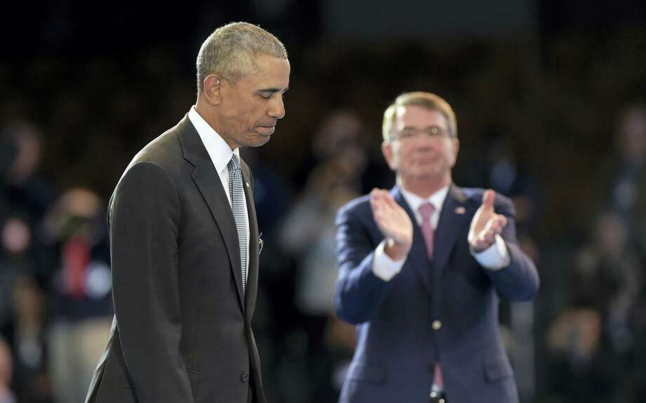Defense Secretary Ash Carter, right, applauds President Barack Obama, left, during an Armed Forces Full Honor Farewell Review on Jan. 4, 2017 at Conmy Hall, Joint Base Myer-Henderson Hall, Va. Photo: AP Photo/Susan Walsh  / Copyright 2017 The Associated Press. All rights reserved.