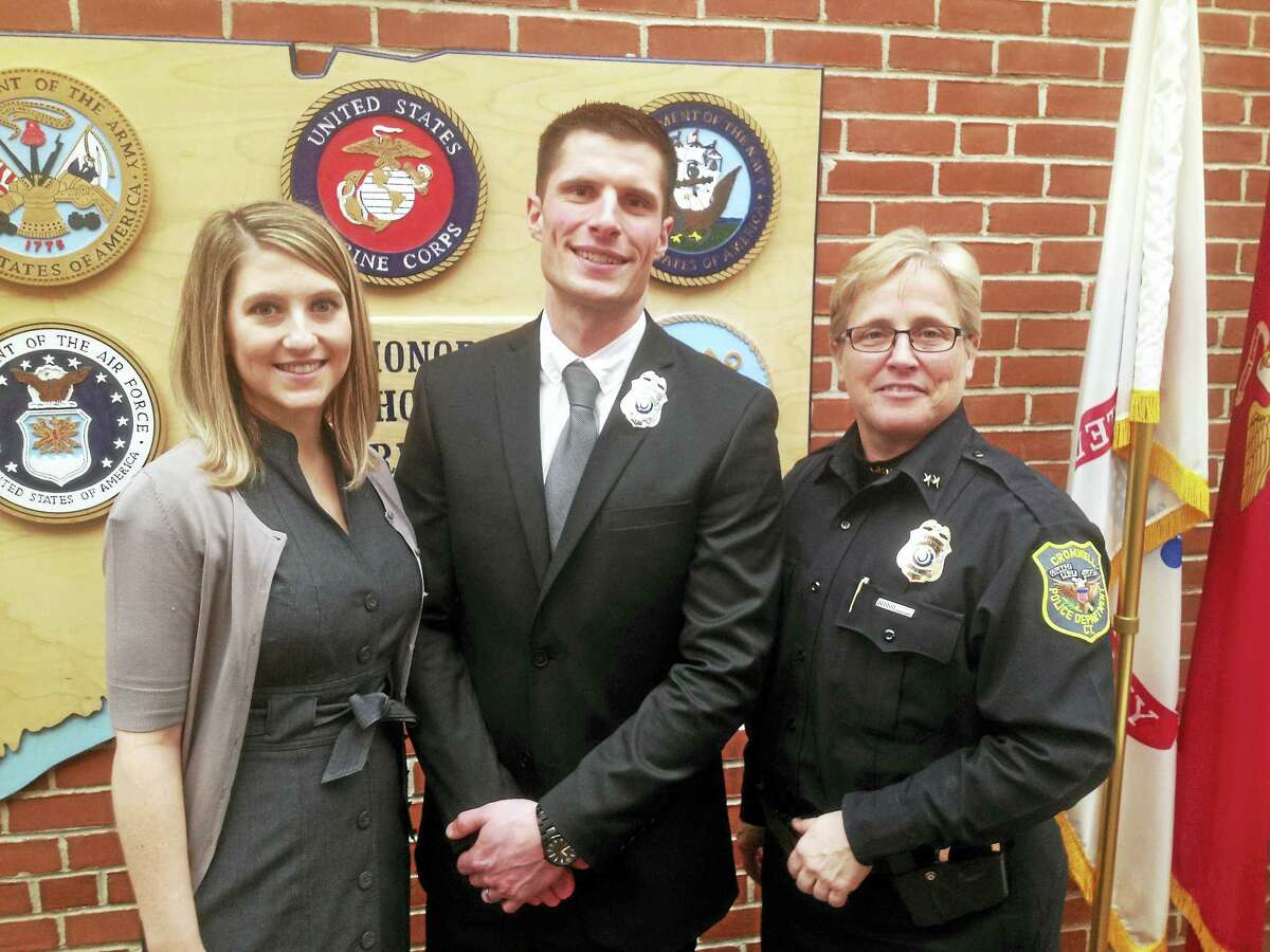 Jennifer and Ryan Wobrock and Cromwell Police Chief Denise Lamontagne are shown following his swearing-in ceremony at Town Hall.