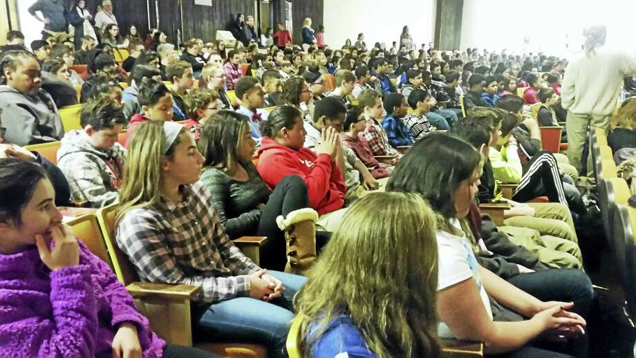 "Students sat rapt in the audience as Chris Lytle spoke — especially when he played a <a href=""https://www.youtube.com/watch?v=gtx5Xc09b90"">montage of his fights</a>. Photo: Kathleen Schassler— The Middletown Press"