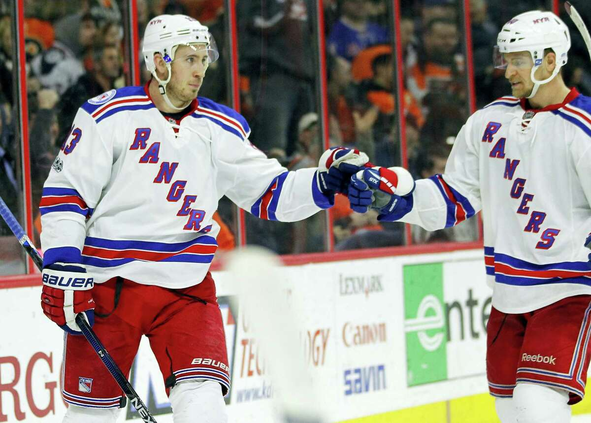 New York Rangers' Kevin Hayes, left, and Michael Grabner, celebrate Hayes' second goal during the third period Wednesday in Philadelphia. The Rangers won 5-2.