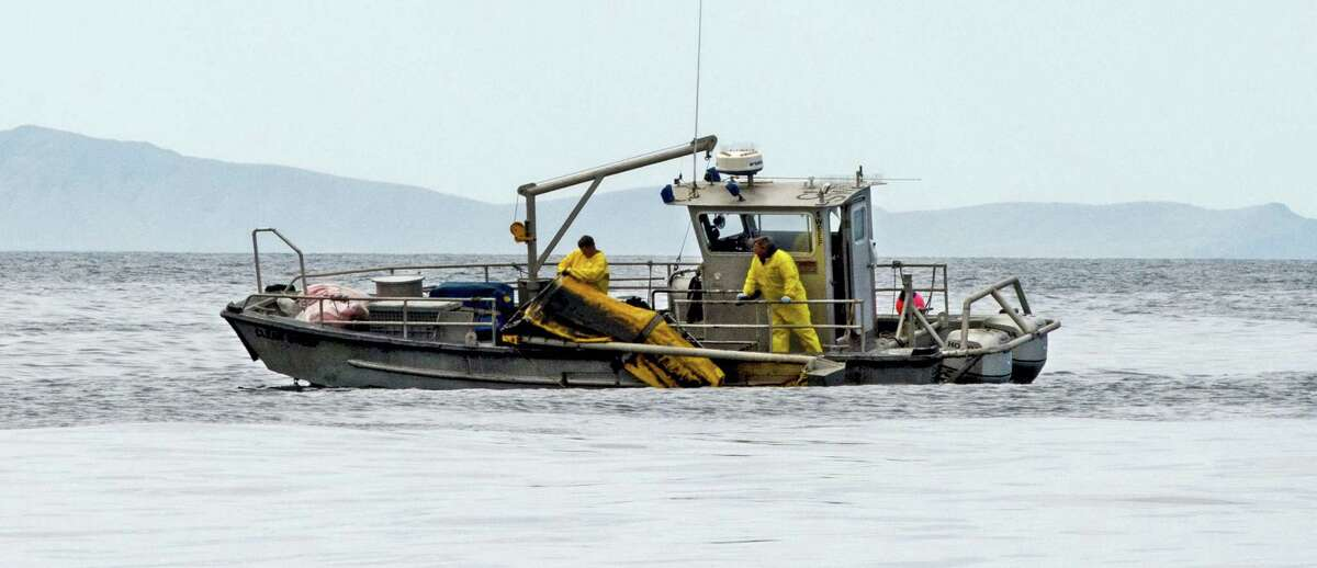Crews recover boom a boom used in oil recovery operations after a spill in the Santa Barbara Channel off Refugio State Beach in Goleta, Calif. on May 21, 2015.
