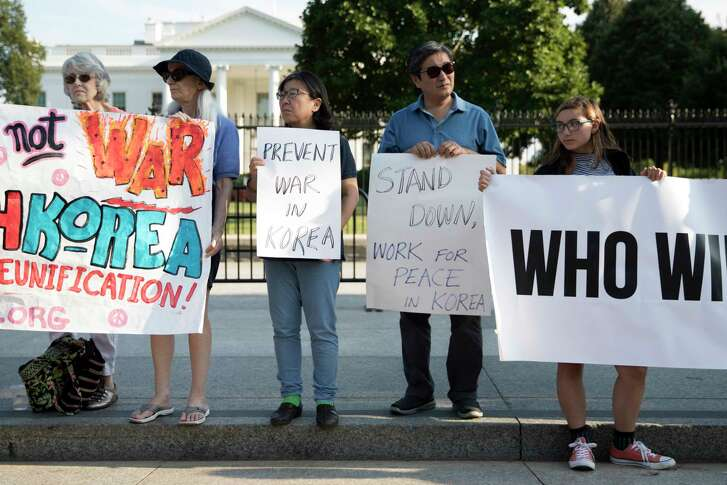 Demonstrators protest against tensions between North Korea and the U.S. outside of the White House in Washington, Aug. 9, 2017. (Tom Brenner/The New York Times)