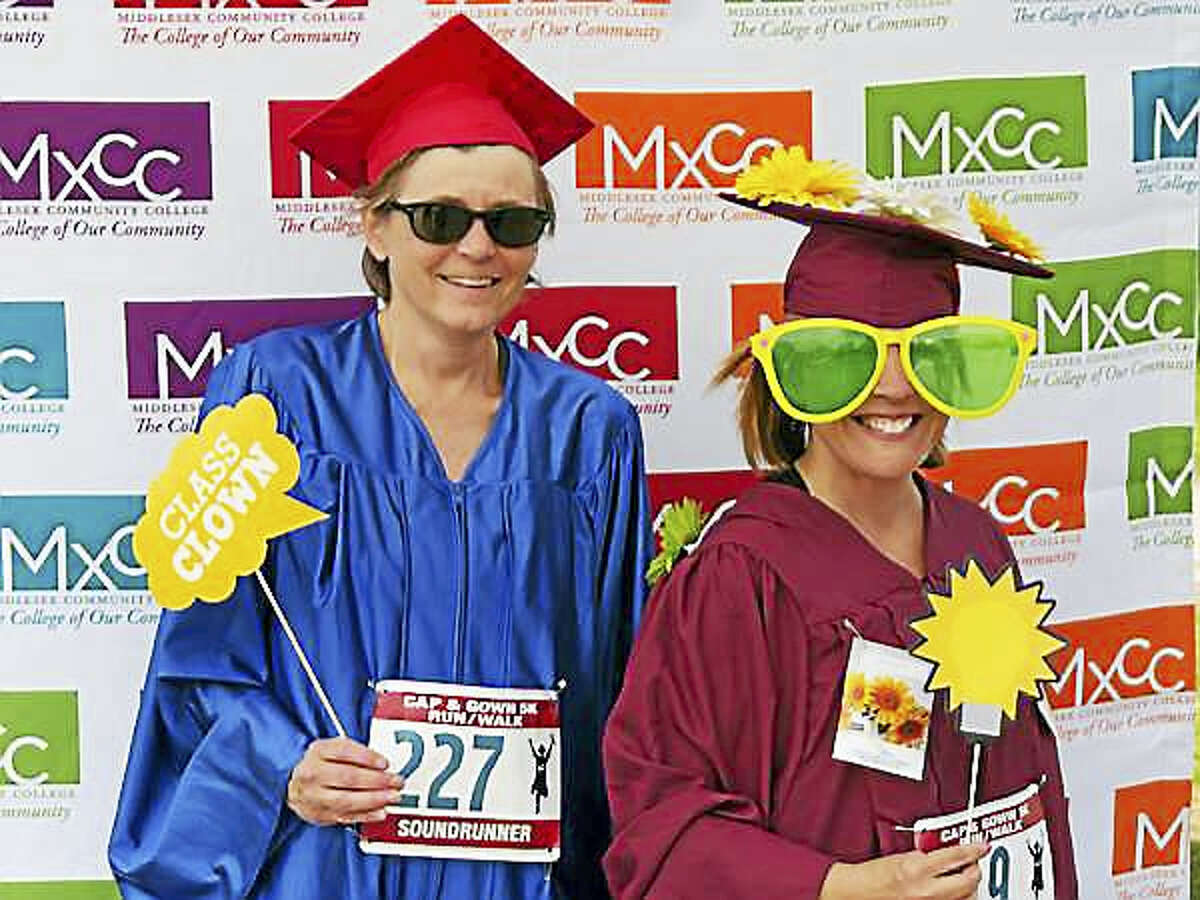 This year's Middlesex Community College Cap & Gown 5K will coincide with the school's 50th anniversary celebration. Here, Kathleen Molski and Christie Billings, both runners who work at Middletown's Russell Library, donned caps and gowns for the 2016 race.