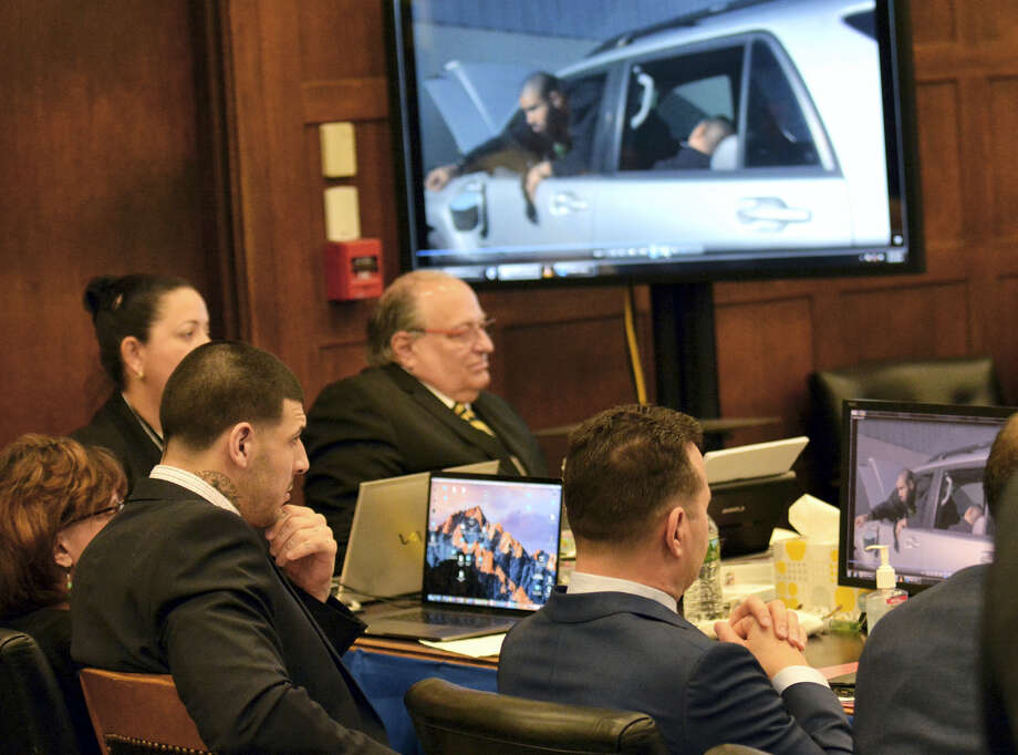 Former New England Patriots tight end Aaron Hernandez and his defense team watch a video of police reenacting Alexander Bradley's version of the events during testimony at Hernandez's double murder trial at Suffolk Superior Court on March 31, 2017 in Boston. Hernandez is standing trial for the July 2012 killings of Daniel de Abreu and Safiro Furtado who he encountered in a Boston nightclub. Hernandez is already serving a life sentence in the 2013 killing of semi-professional football player Odin Lloyd. Photo: Chris Christo — The Boston Herald Via AP, Pool  / Pool The Boston Herald