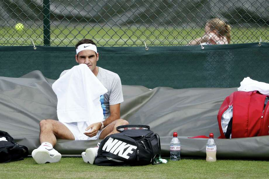 Roger Federer attends a training session at the All England Lawn Tennis Championships in Wimbledon, London on Saturday. Photo: Peter Klaunzer — Keystone Via AP  / © KEYSTONE / PETER KLAUNZER