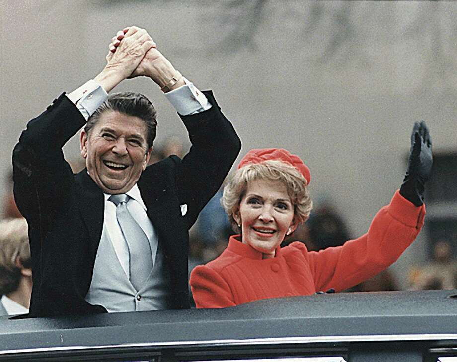 President Ronald Reagan and first lady Nancy Reagan wave during Reagan's first inauguration in Washington, D.C., Jan. 20, 1981. Photo: National Archives/MCT  / MCT