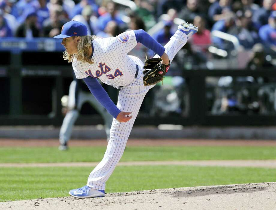 Mets starting pitcher Noah Syndergaard throws during the fourth inning against the Braves on Monday. Photo: Seth Wenig — The Associated Press  / AP