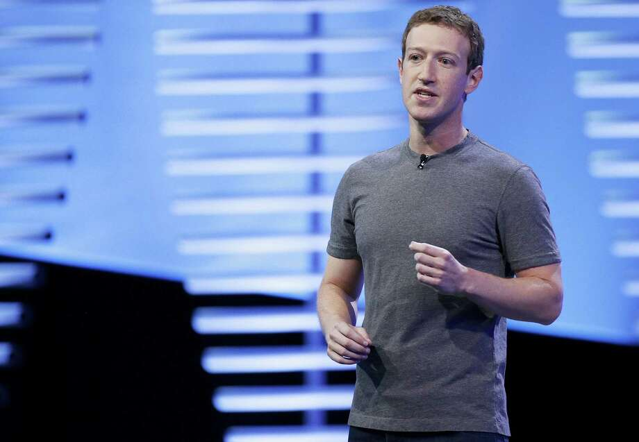 AP Photo—Eric Risberg In this April 12, 2016, file photo, Facebook CEO Mark Zuckerberg speaks during the keynote address at the F8 Facebook Developer Conference in San Francisco. In a blog post Wednesday, May 3, 2017, Zuckerberg said that Facebook will hire another 3,000 people to review videos of crime and suicides following murders shown live. Photo: AP / Copyright 2016 The Associated Press. All rights reserved. This material may not be published, broadcast, rewritten or redistribu