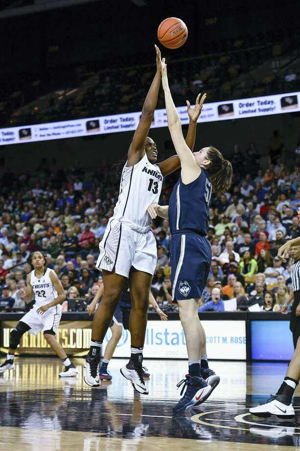 Central Florida center Kayla Thomas shoots over UConn center Natalie Butler during an NCAA college basketball game, Sunday in Orlando, Fla. Butler is averaging 6.4 points and 4.6 rebounds per game for the Huskies. Photo: ROY K. MILLER - THE ASSOCIATED PRESS  / FR171497 AP