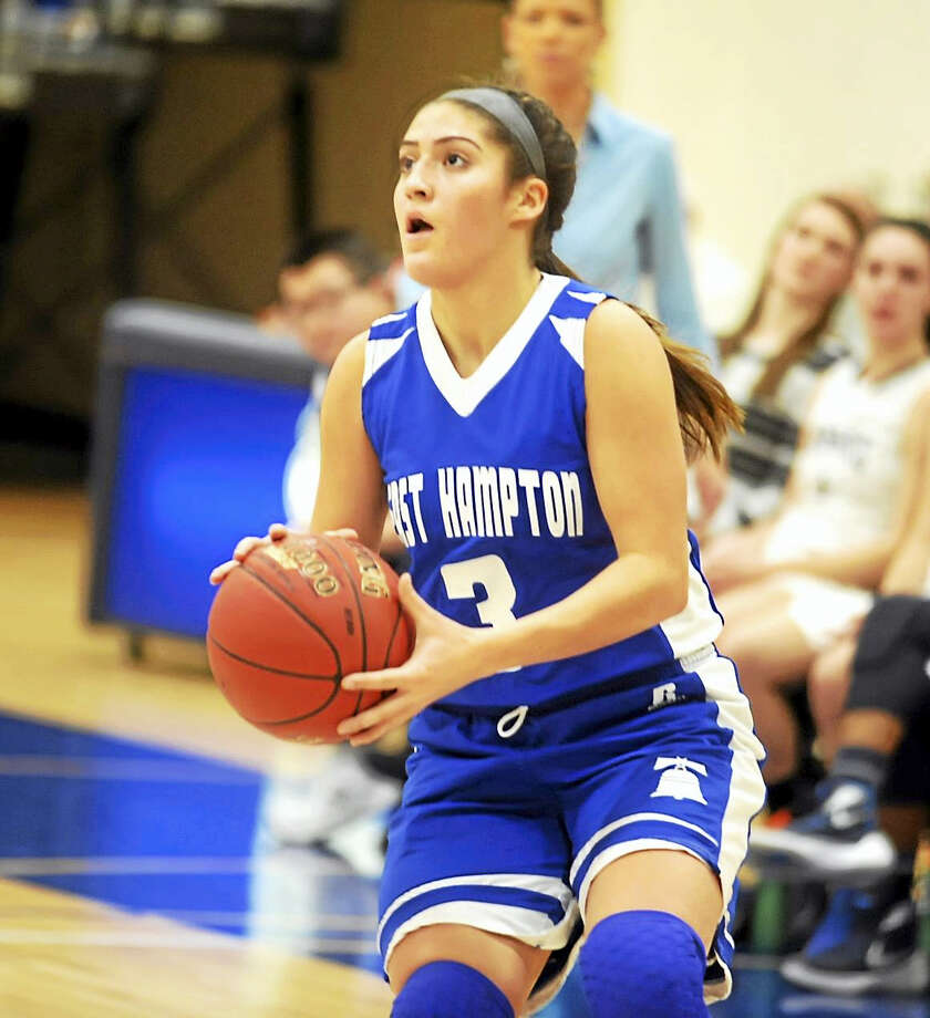 East Hampton senior Gyanna Russell scored her 1000th career point in the Bellringers' 51-44 win Tuesday night in Clinton. Photo: Jimmy Zanor - The Middletown Press