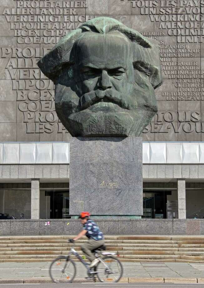 A cyclist passes the bust of  Karl Marx, the German philosopher, sociologist, economic historian, journalist and revolutionary socialist who developed the theory of Marxism, in Chemnitz, Germany. Photo: File Photo  / dapd