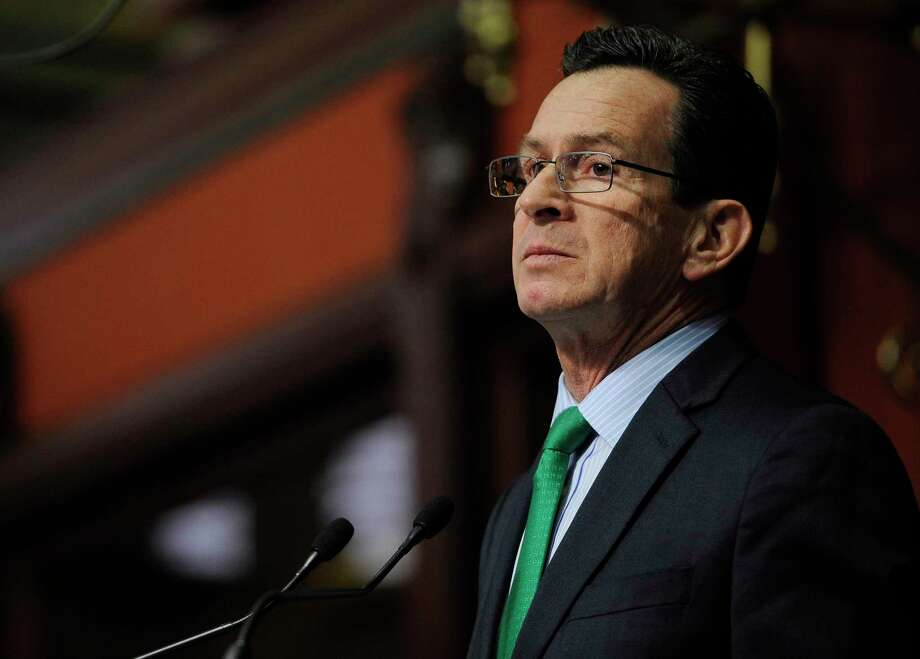 Gov. Dannel P. Malloy delivers his budget address to the Senate and House inside the Hall of the House at the State Capitol. Photo: Associated Press File Photo  / FR125654 AP