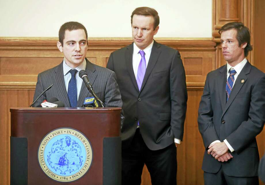 Steve Kennedy, left, an Army veteran and Connecticut team leader of Iraq and Afghanistan Veterans of America, speaks about the Honor Our Commitment Act Monday. With Kennedy are, from left, U.S. Sen. Chris Murphy and Tom Burke,  Marine Corps veteran and president of the Yale Student Veterans Council. Photo: Arnold Gold — New Haven Register