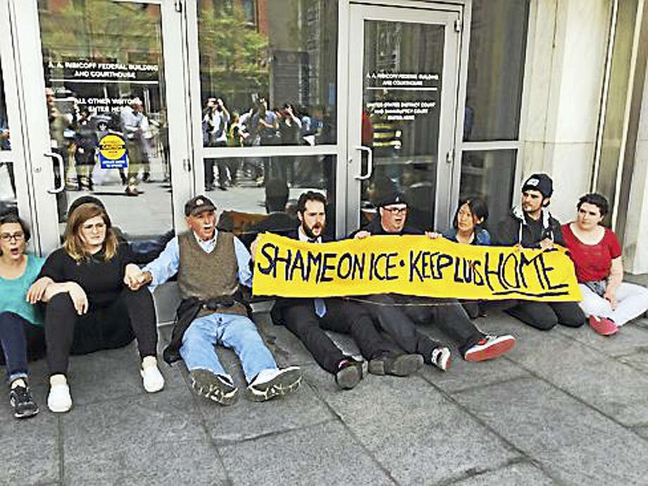 Protesters block the door to the federal building in Hartford. Photo: Jack Kramer — Ctnewsjunkie