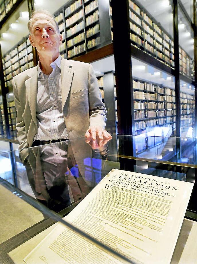 George Miles, the William Robertson Coe curator of Western Americana at Yale University's Beinecke Rare Book and Manuscript Library at Yale University with a first printed edition of the Declaration of Independence by John Dunlap in Philadelphia on July 4, 1776, displayed at the library. Photo: Peter Hvizdak / Hearst Connecticut Media  / Peter Hvizdak
