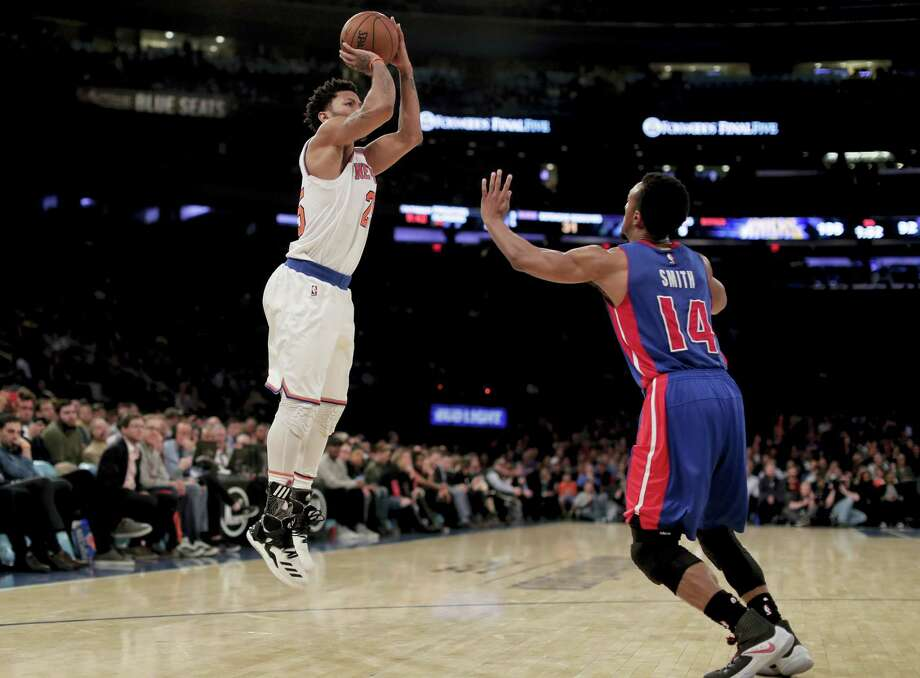 New York Knicks guard Derrick Rose (25) puts up a shot against Detroit Pistons guard Ish Smith (14) during the fourth quarter of an NBA basketball game on March 27, 2017 in New York. The Knicks won 109-95. Photo: AP Photo — Julie Jacobson  / Copyright 2017 The Associated Press. All rights reserved.
