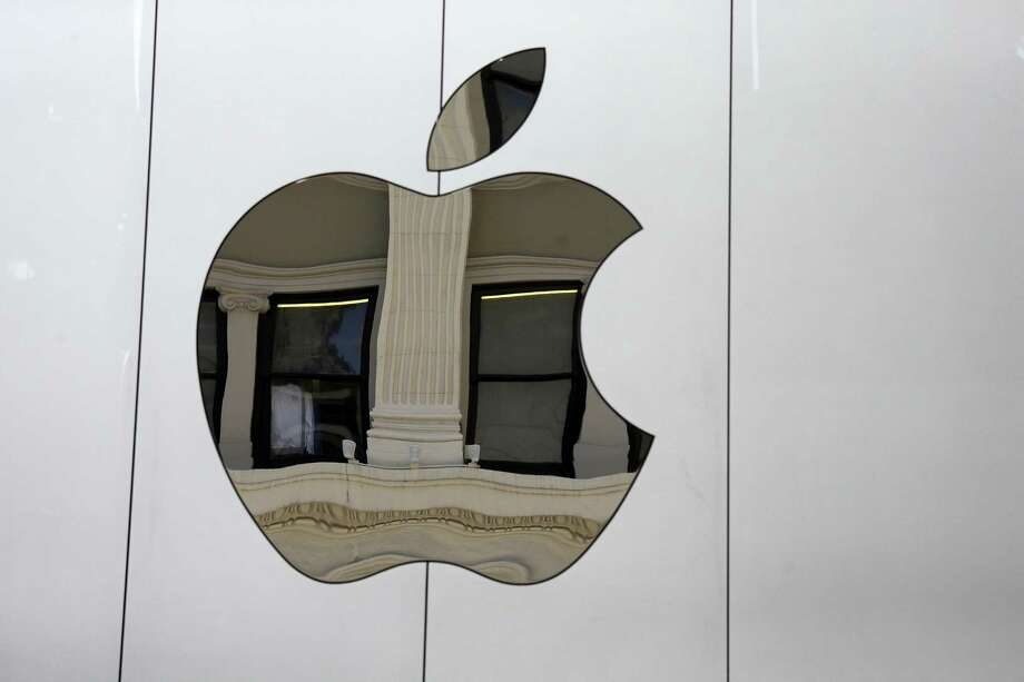 FILE - This Thursday, May 19, 2016, file photo shows the Apple logo on the side of the Apple Union Square store, in San Francisco. Apple reports earnings Tuesday, May 2, 2017. Photo: AP Photo­ — Eric Risberg  / Copyright 2017 The Associated Press. All rights reserved.