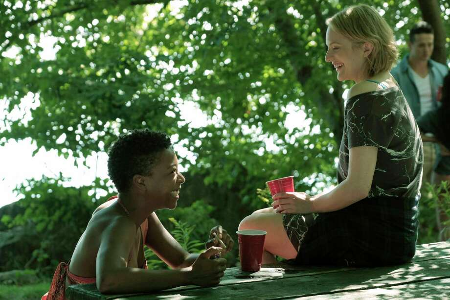 "(L-r) Moira (Samira Wiley) and Offred (Elisabeth Moss) in ""The Handmaid's Tale."" Photo: George Kraychyk, Hulu / 2016 Hulu"