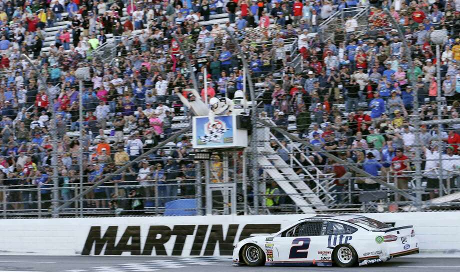 Brad Keselowski crosses the finish line to win at Martinsville Speedway on Sunday. Photo: Steve Helber — The Associated Press  / Copyright 2017 The Associated Press. All rights reserved.