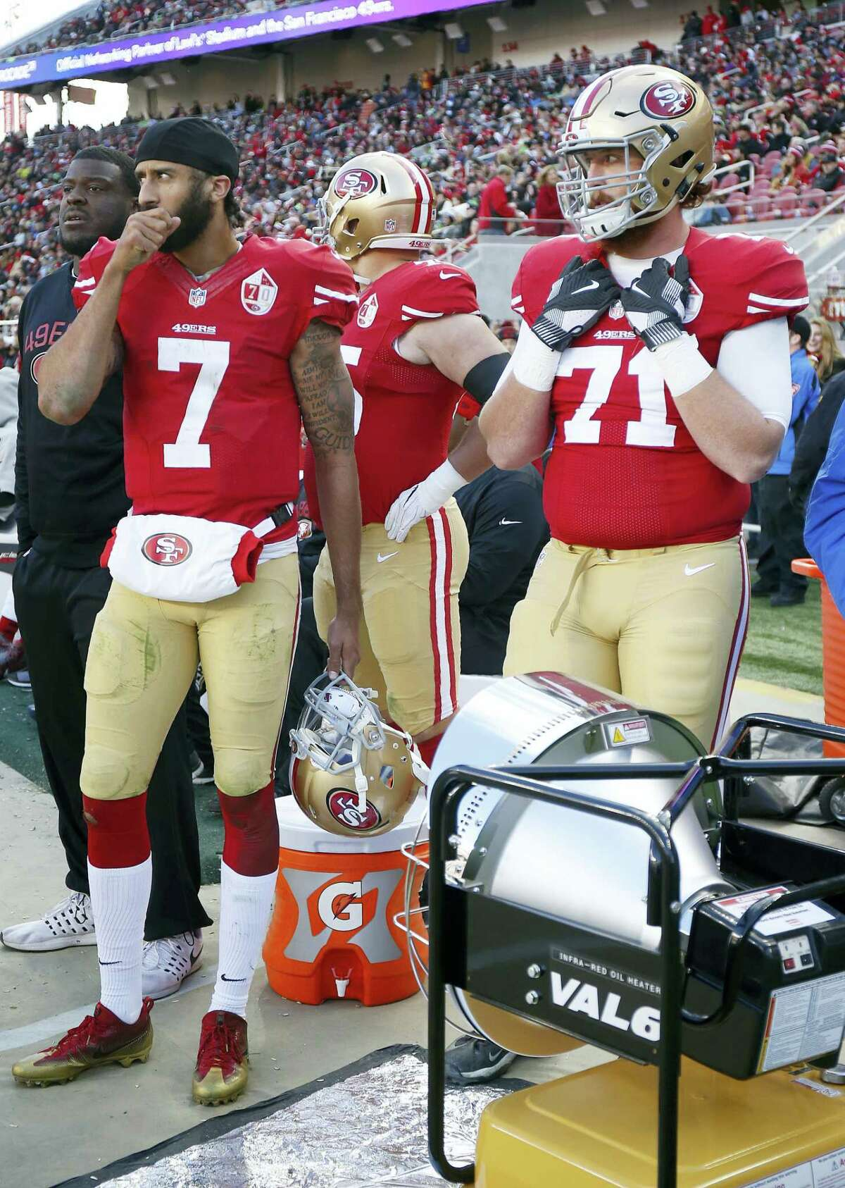 San Francisco 49ers quarterback Colin Kaepernick (7) and offensive tackle John Theus (71) stand on the sideline during the second half of an NFL football game against the Seattle Seahawks in Santa Clara, Calif. on Jan. 1, 2017.