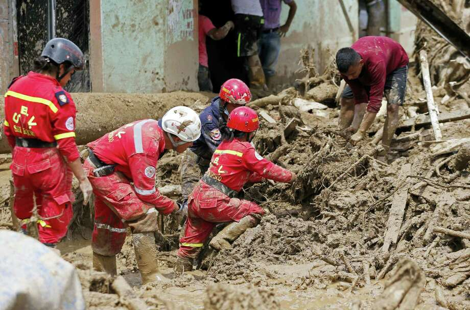 Rescuers search for survivors in Mocoa, Colombia on April 2, 2017. A grim search for the missing resumed at dawn Sunday in southern Colombia after surging rivers sent an avalanche of floodwaters, mud and debris through a city, killing at least 200 people and leaving many more injured and homeless. Photo: AP Photo — Fernando Vergara  / Copyright 2017 The Associated Press. All rights reserved.