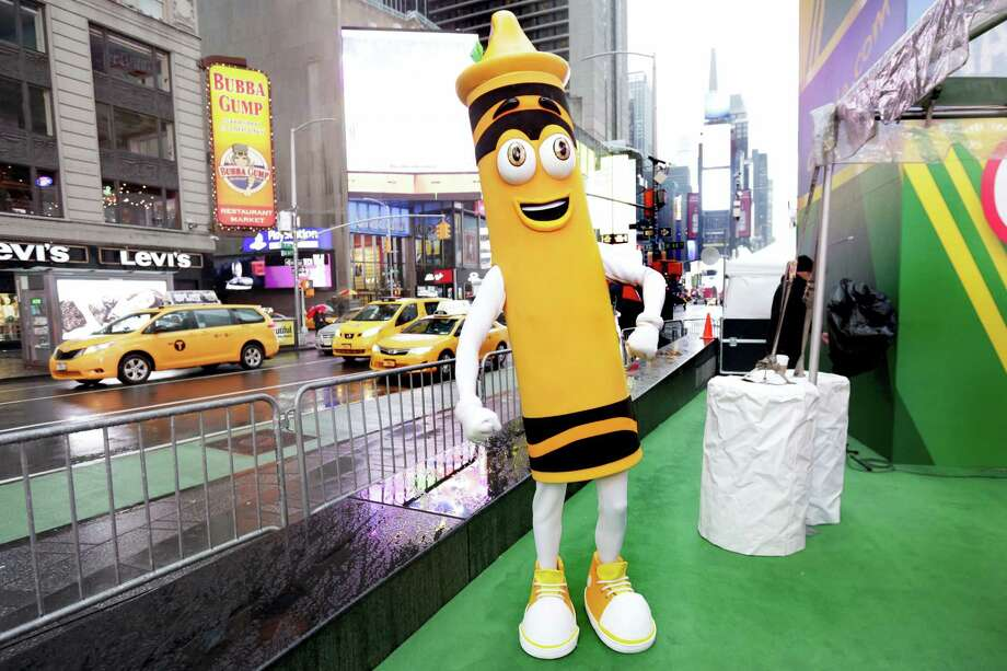 "A dandelion crayon character poses for photos during a Crayola event in New York's Times Square, Friday, March 31, 2017. Crayola announced Friday, National Crayon Day, that it's replacing the color dandelion in its 24-pack with a crayon in ""the blue family."" Photo: AP Photo/Richard Drew   / AP"
