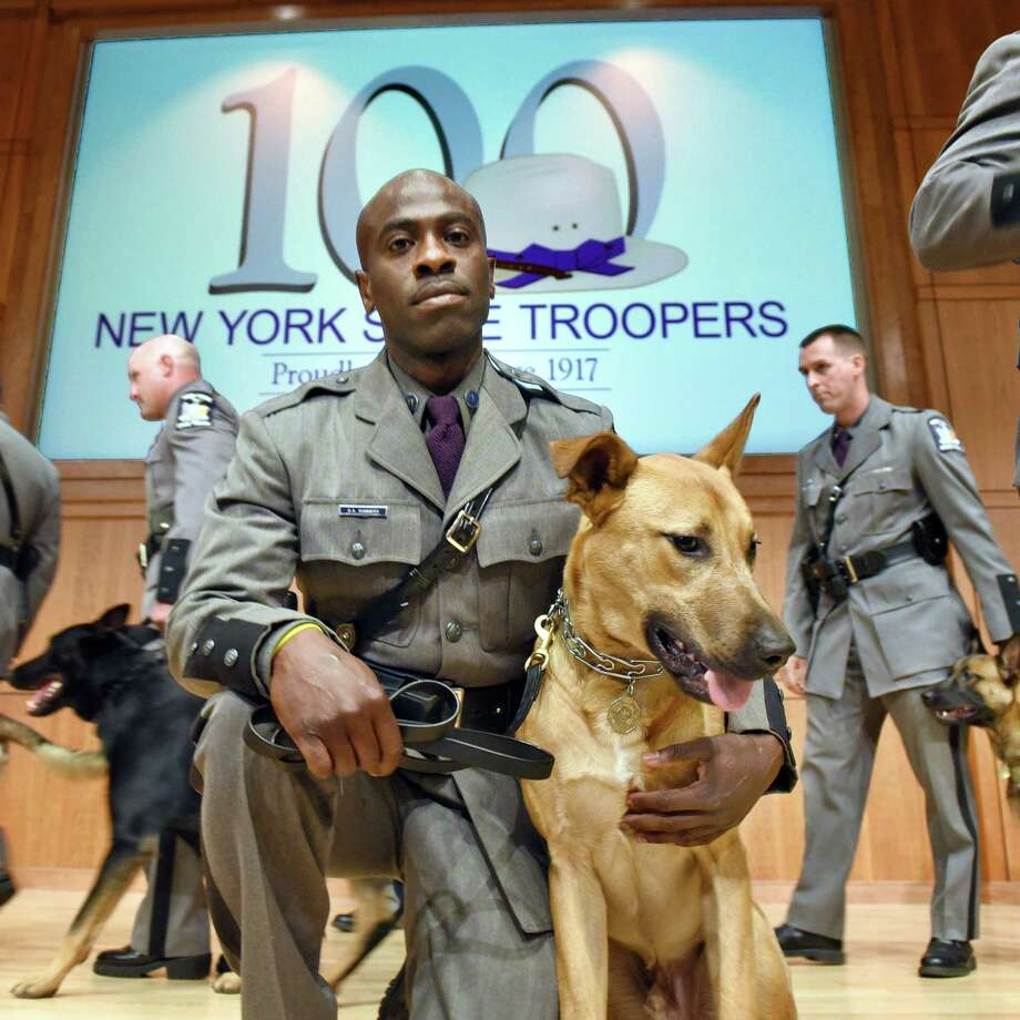 Trooper Dermont A. Summers of Troop NYC and Canine Theo on stage at the at the state police academy for Canine Handler Basic School graduation Friday August 11, 2017 in Albany, NY.  (John Carl D'Annibale / Times Union) Photo: John Carl D'Annibale / 20041265A