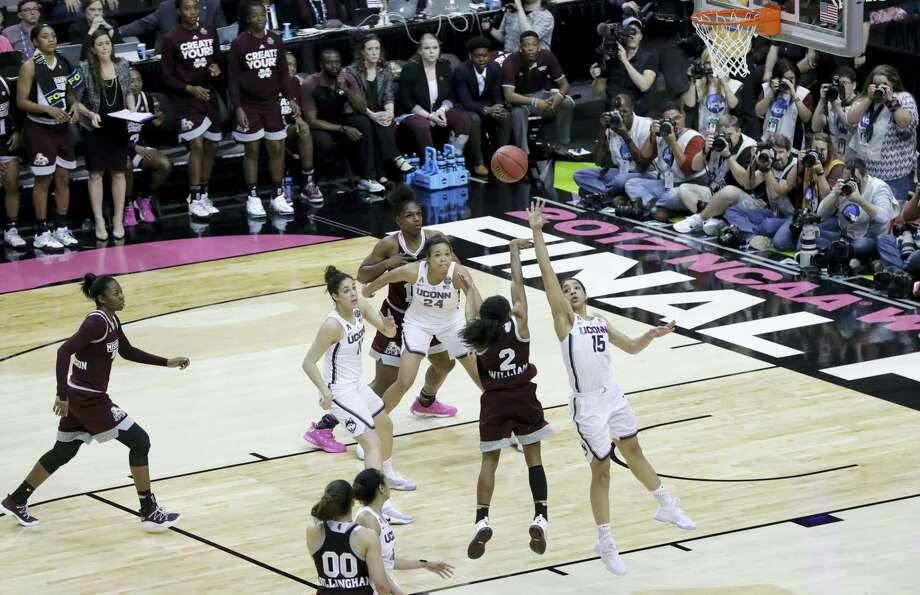 Mississippi State guard Morgan William (2) shoots the winning shot against UConn during Friday's national semifinal at the Final Four in Dallas. Mississippi State won 66-64 in overtime. Photo: Eric Gay — The Associated Press  / Copyright 2017 The Associated Press. All rights reserved.