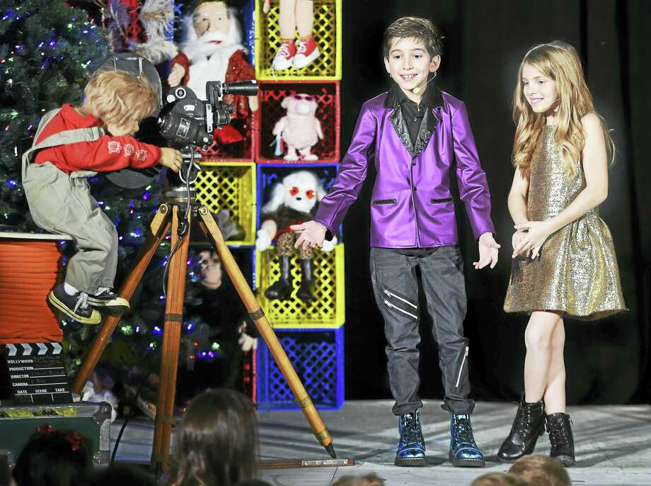 Magician Kadan Bart Rockett and his sister, Brooklyn, tape a segment for Facebook Live at PUCUDA/ Leading Edge in Madison. Photo: Arnold Gold — New Haven Register