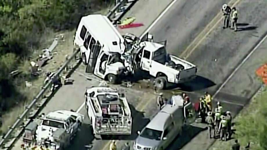 In this aerial image made from a video provided by KABB/WOAI authorities respond to a deadly crash involving a van carrying church members and a pickup truck on U.S. 83 outside Garner State Park in northern Uvalde County, Texas, Wednesday, March 29, 2017. The group of senior adults from First Baptist Church of New Braunfels, Texas, was returning from a retreat when the crash occurred, a church statement said. Photo: KABB/WOAI Via AP   / Courtesy KABB/WOAI