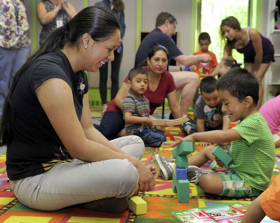 Betty Samaniego and son Diego Cambizaca, 3, laugh as they play with building blocks during a weekly class offered by The United Way of Western Connecticut. The class is a pilot program for the largely-Latino neighborhood around the Park Avenue Elementary School to teach parents how to be the primary educators of their children. Studies indicate Latino parents understand the importance of education for their children. Photo: Carol Kaliff /Hearst Connecticut Media / The News-Times
