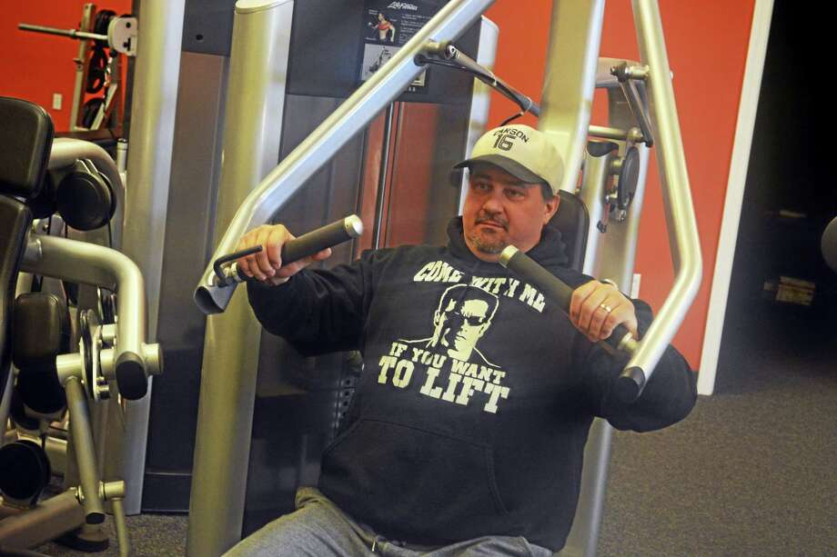 Merle Mckenzie, co-owner with his wife Diana of Crossfit Ironworks in the Higganum section of Haddam, just opened a small commercial gym down the street — the first in this small town of 7,100 residents. Photo: Cassandra Day — The Middletown Press
