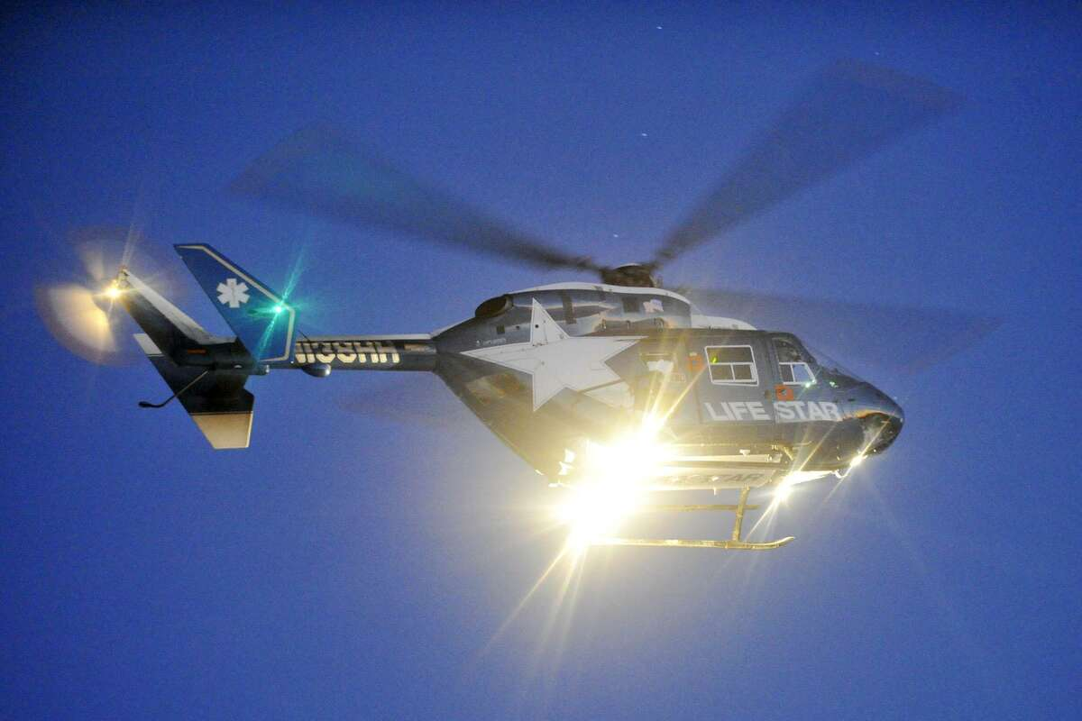 A Life Star medical helicopter landed at Kosciuszko Park in Stamford, Conn., on Jan. 29, 2014, to transport a patient. Such lifesaving services, including those in Texas, are threatened because of difficult business models - something a bill in Congress addresses.