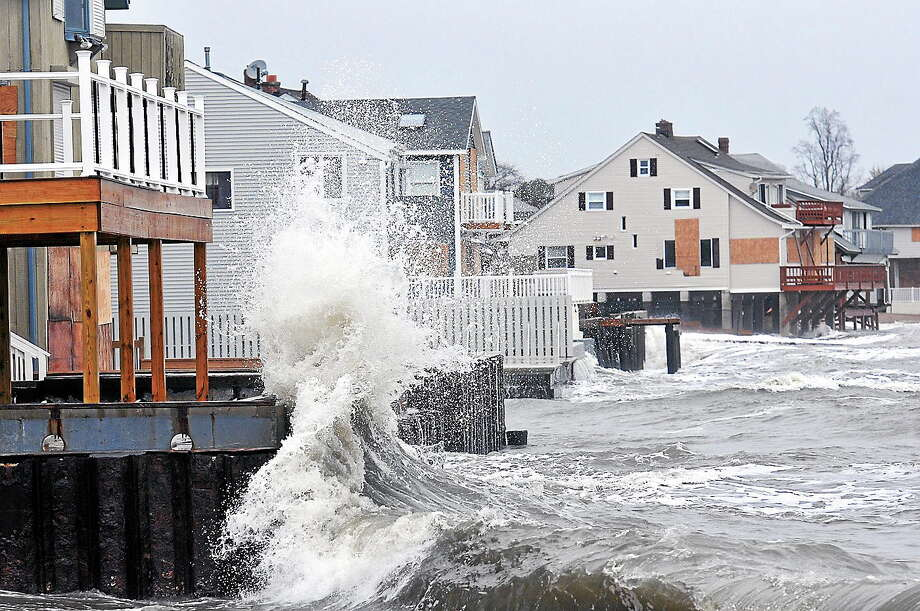 Waves slam against the homes along Cosey Beach in East Haven during low tide. Photo: New Haven Register File Photo