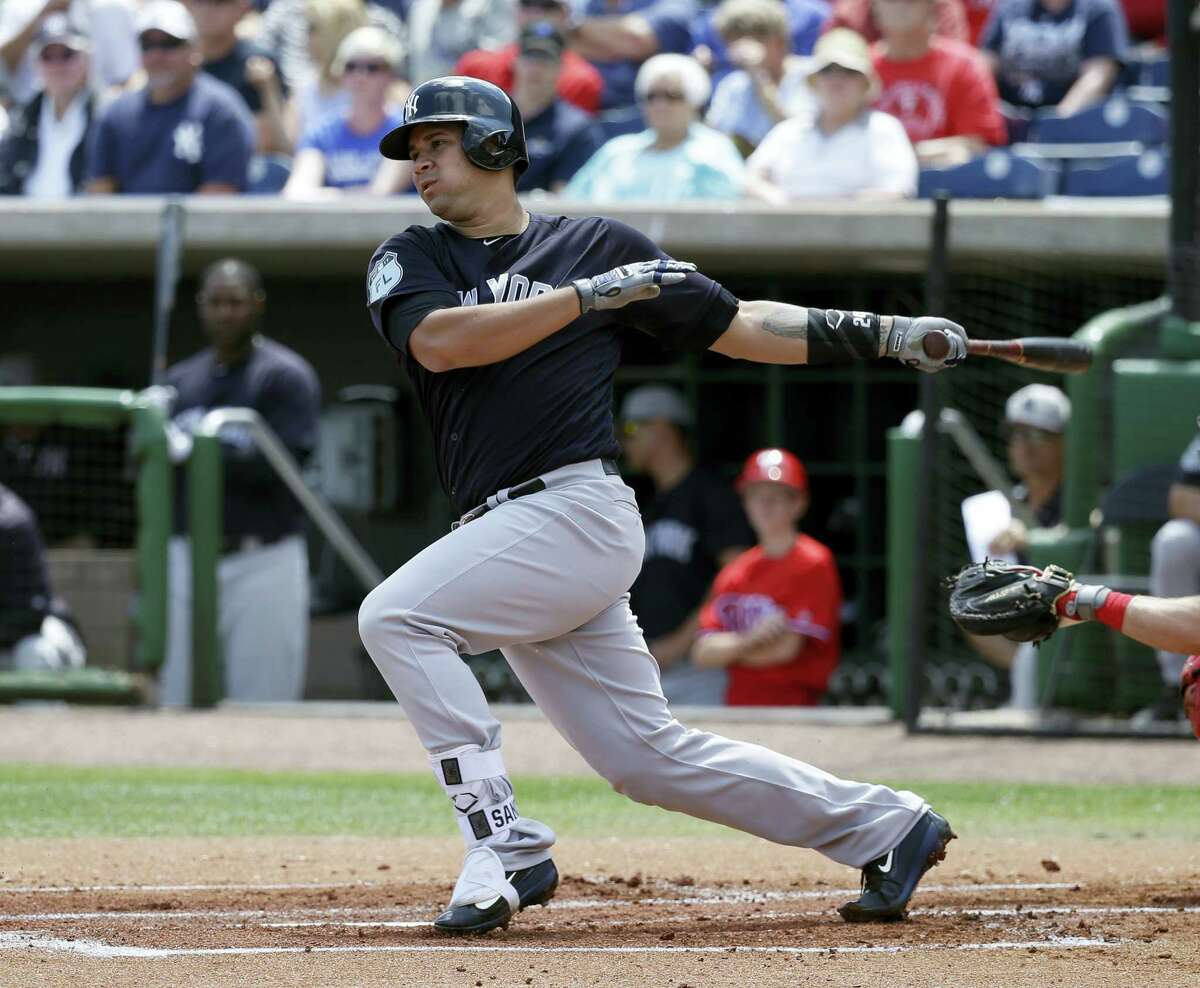 The Yankees' Gary Sanchez bats against the Phillies during a spring training game.