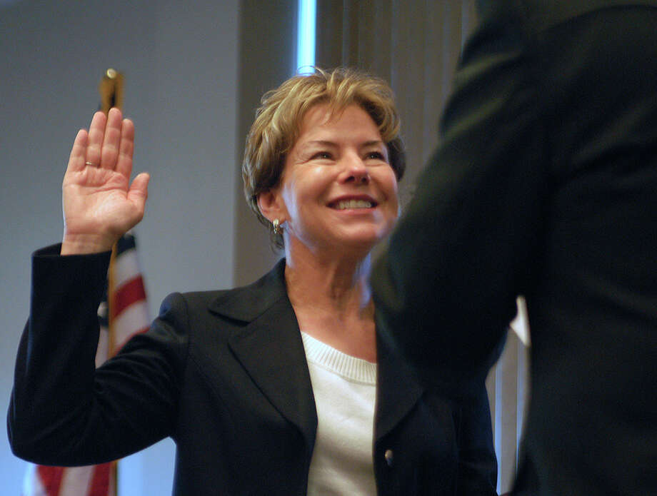 284th District Court Judge Cara Wood is sworn in by Retiring District Court Judge Olen Underwood.  The ceremony to administer the oath of office to elected officials was held at the Lone Star Convention Center on New Year's Day Photo: David Hopper, Freelance / Freelance