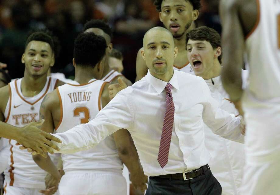 Texas Longhorns head coach Shaka Smart congratulates his team during the Lone Star Shootout game against Arkansas at the Toyota Center on Saturday, Dec. 17, 2016, in Houston.  ( Elizabeth Conley / Houston Chronicle ) Photo: Elizabeth Conley, Staff / © 2016 Houston Chronicle