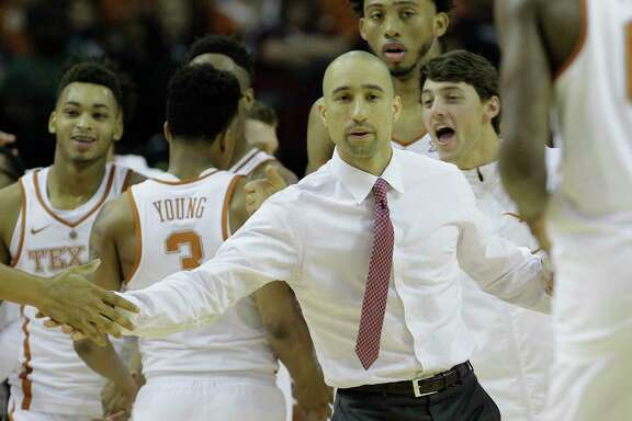 Texas Longhorns head coach Shaka Smart congratulates his team during the Lone Star Shootout game against Arkansas at the Toyota Center on Saturday, Dec. 17, 2016, in Houston.  ( Elizabeth Conley / Houston Chronicle )