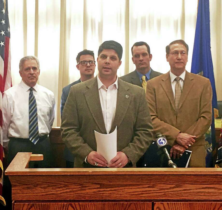 Last year, Middletown Mayor Dan Drew announced that Standard & Poor's Rating Services awarded the city a AAA bond rating, the highest possible designation a city can receive. S&P reaffirmed the rating again last week. In this file photo, Drew is shown with Common Council Minority Leader Sebastian Giuliano, Councilman Robert Blanchard, the city's financial adviser Matt Spoerndle and Majority Leader Thomas Serra. Photo: File Photo