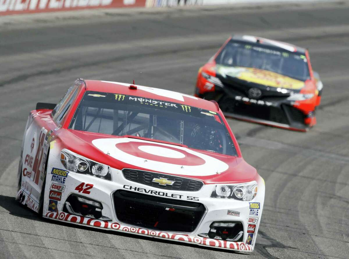 Kyle Larson, left, leads Martin Truex Jr. during Sunday's race at Auto Club Speedway in Fontana, California, on Sunday.