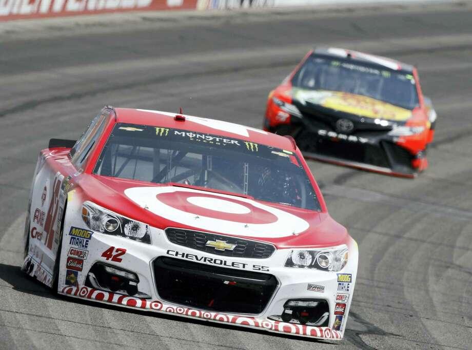 Kyle Larson, left, leads Martin Truex Jr. during Sunday's race at Auto Club Speedway in Fontana, California, on Sunday. Photo: Alex Gallardo — The Associated Press  / FR170211 AP